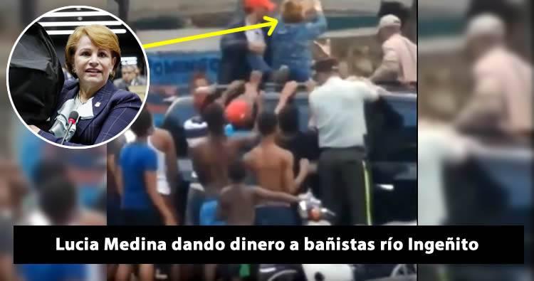 Captan a Lucia Medina dando dinero a bañistas en un río de San Juan de la Maguana